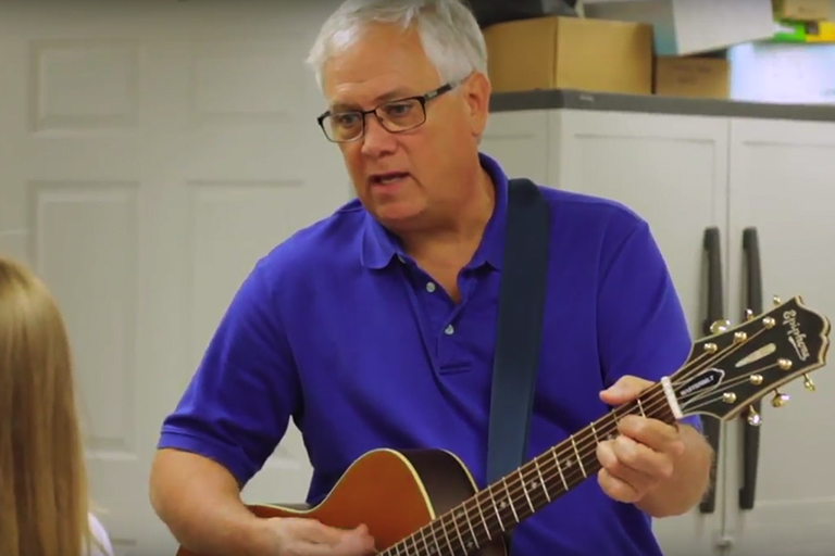 Screenshot of Dr. Wright playing guitar at Harrisonburg Family & Cosmetic Dentistry