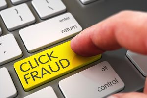 "Finger clicking ""Click Fraud"" Google Adwords button"